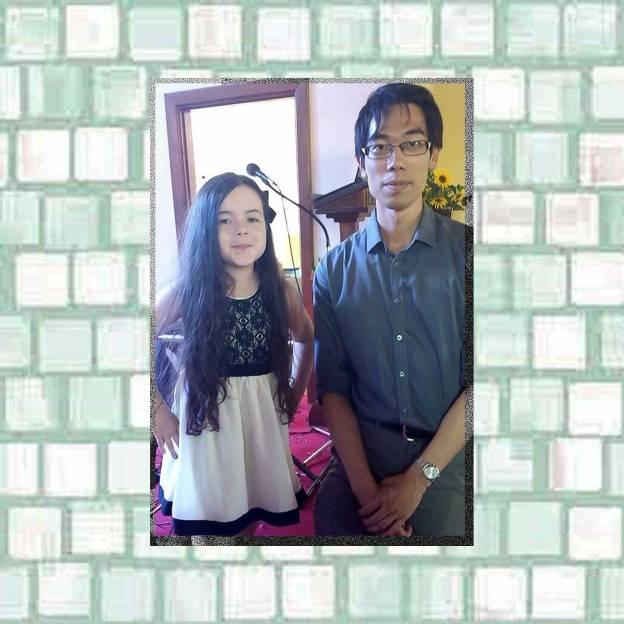 Tookii with piano teacher Hou