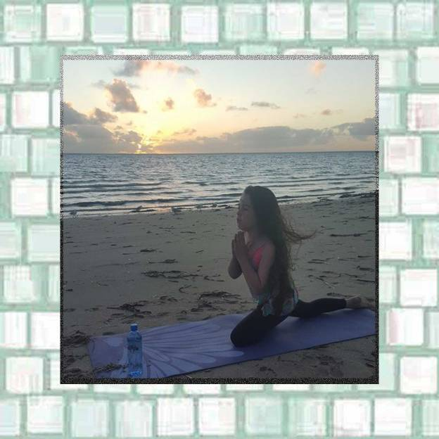 Tookii practices yoga on the beach