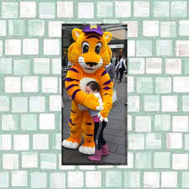 Tookii hugs a tiger