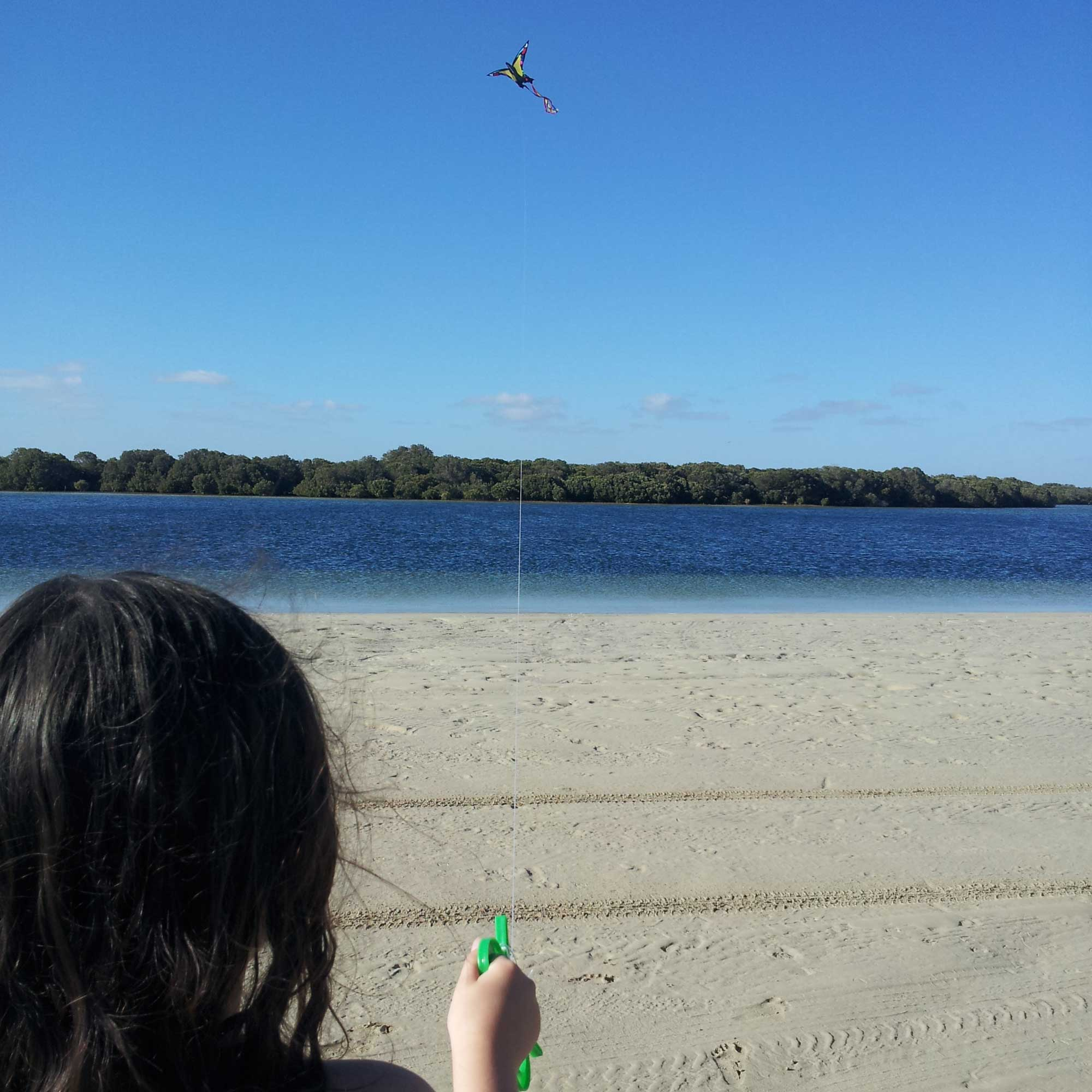 Tookii things to do with kids with her kite one of the summer activities for kids