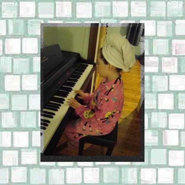Tookii practicing piano