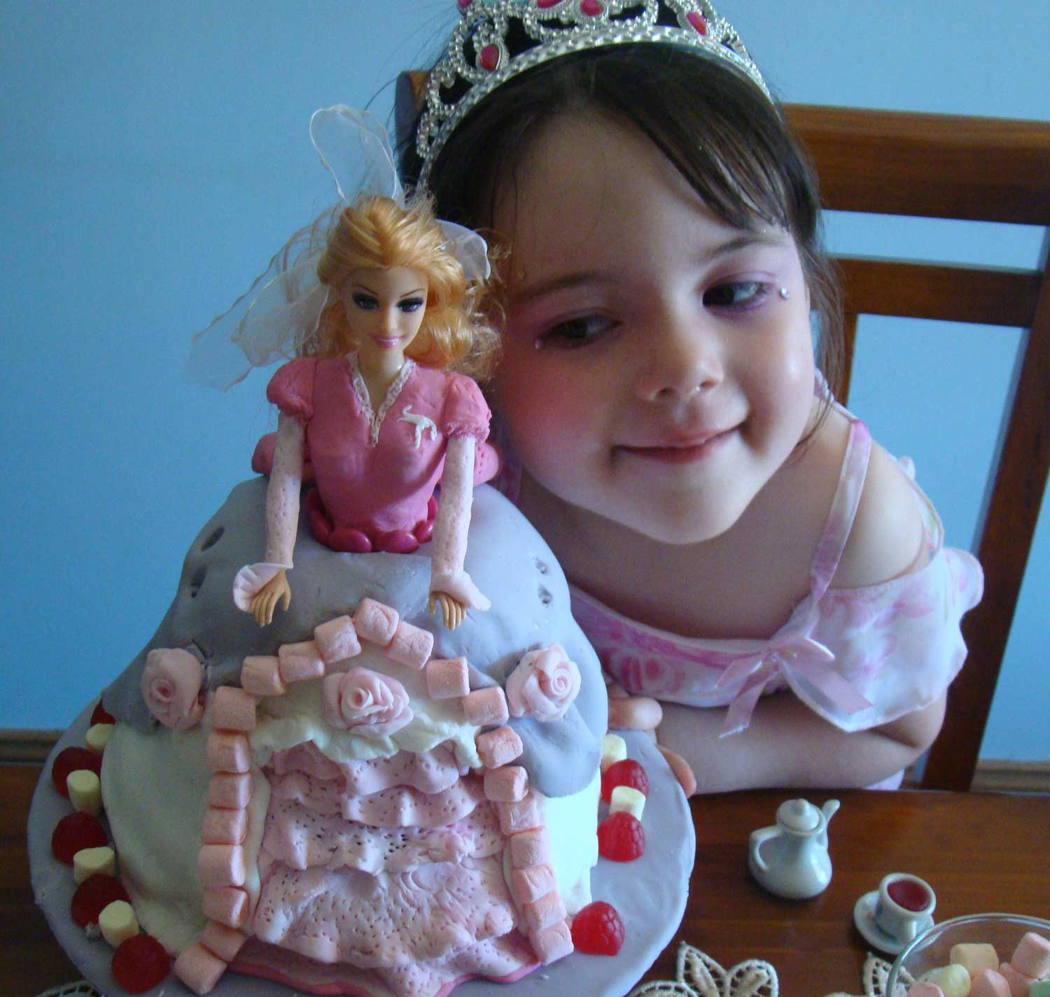 Tookii things to do with kids with her doll birthday cake one of the activities for kids