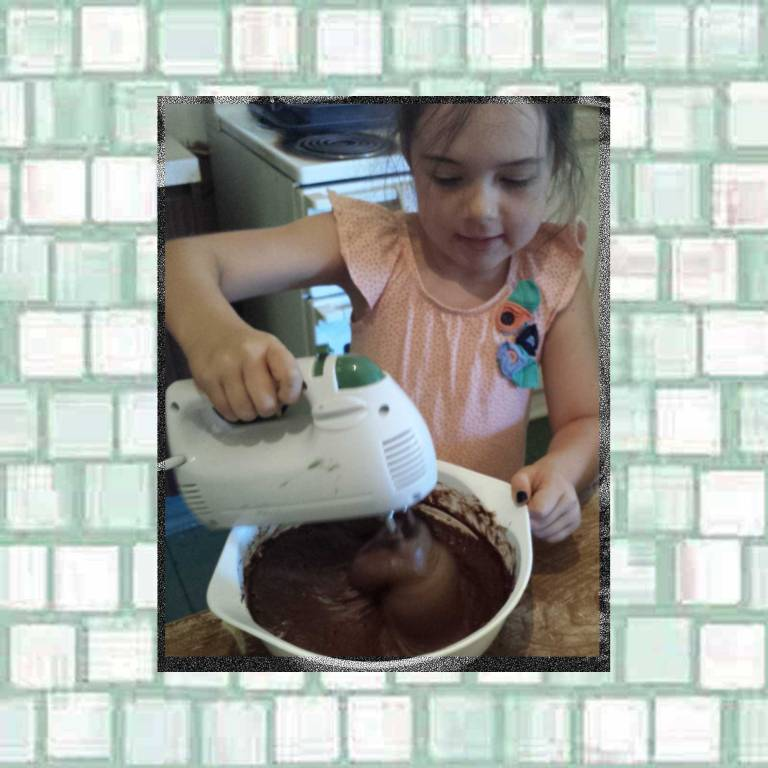 Tookii mixing the cake batter