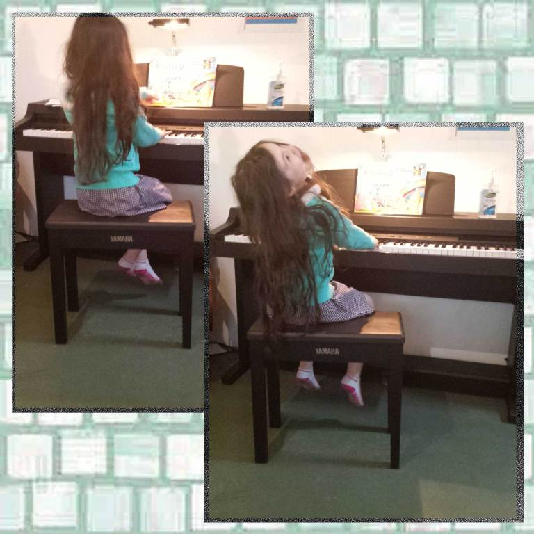 Tookii sitting at the piano