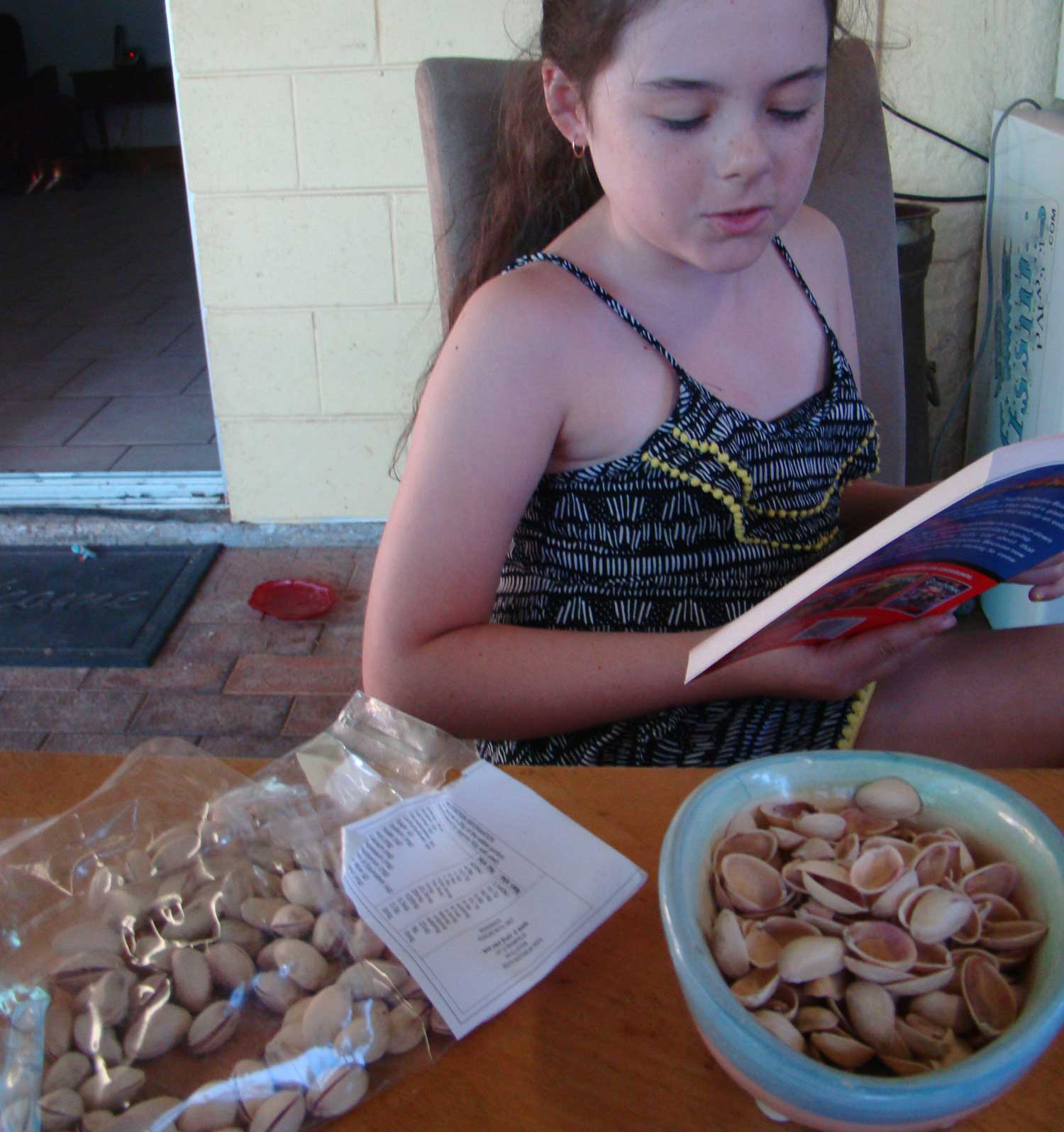 Tookii things to do with kids reading and eating nuts one of the activities for kids