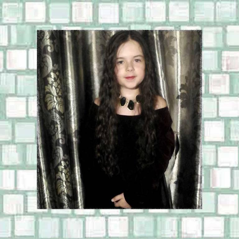 Tookii in black dress