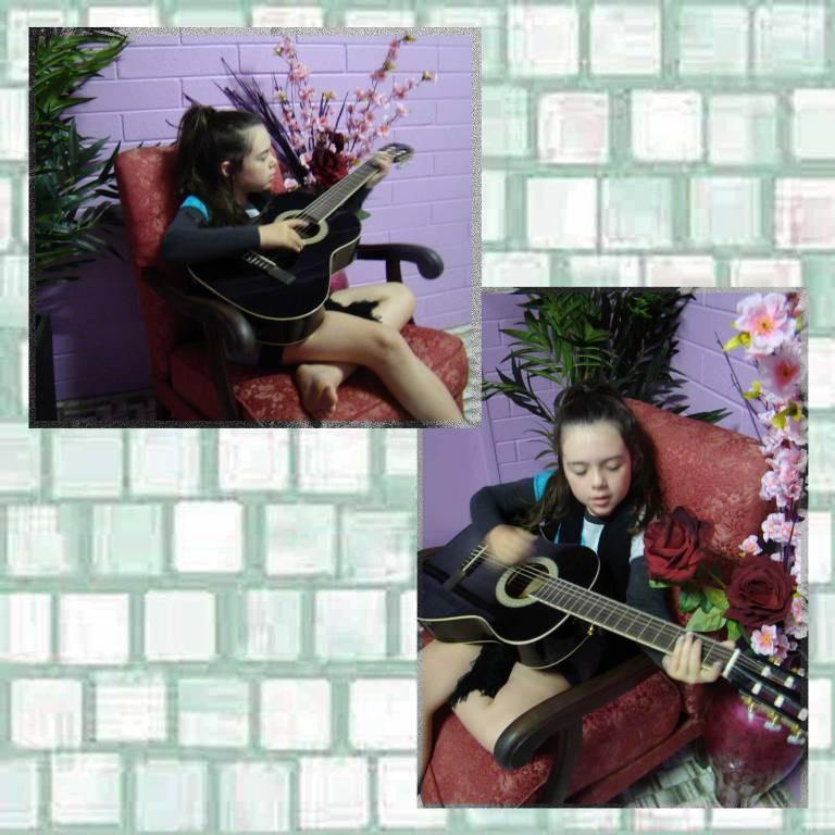 Tookii playing guitar